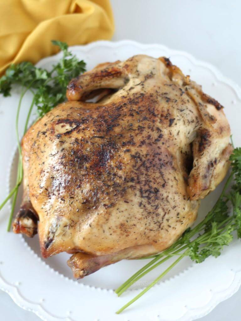 Slow Cooker Rotisserie Chicken. A simple and delicious herbed chicken dinner made in your crock pot or slow cooker. Gluten-free, paleo. | www.downshiftology.com
