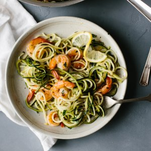 This zucchini pasta with lemon garlic shrimp is a delicious, gluten-free (and of course low-carb) version of shrimp scampi and linguini. Traditional pasta is replaced with zucchini noodles or zucchini pasta for a lighter, healthier meal.