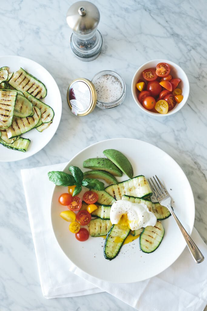 This poached egg with truffle salt grilled zucchini recipe proves that breakfast doesn't have to be complicated to be delicious.