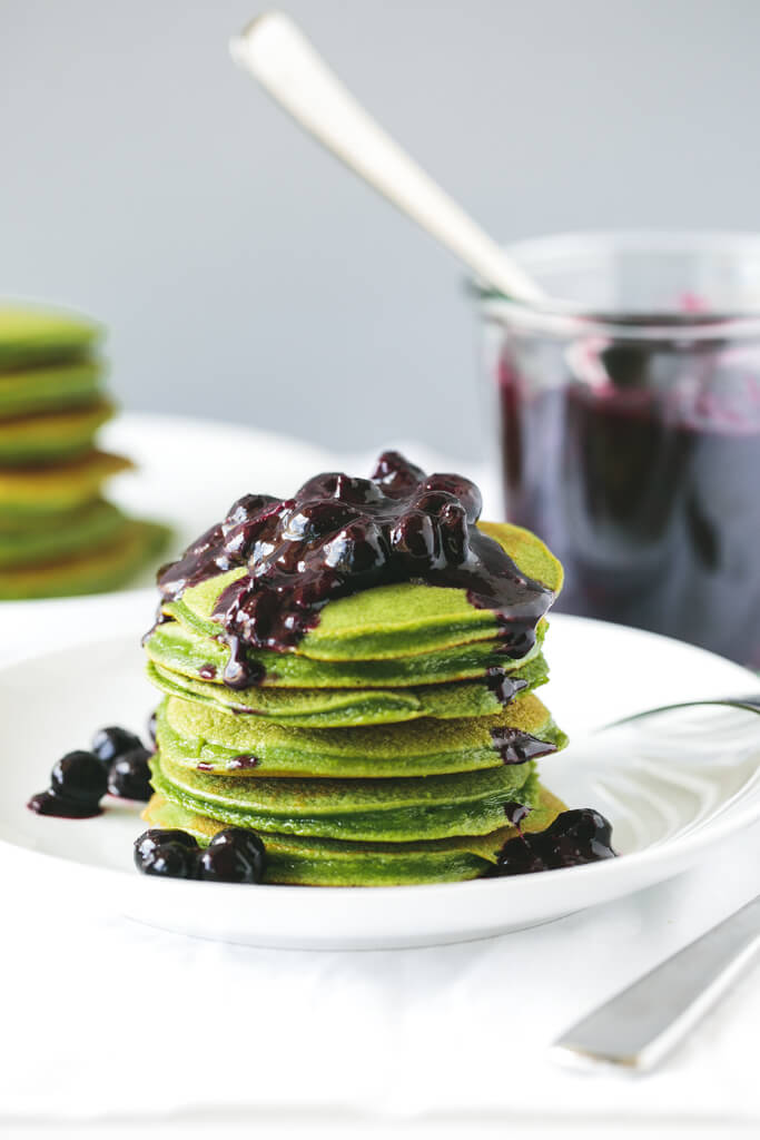(gluten-free, paleo) Green Smoothie Pancakes with Macerated Blueberries. These light and fluffy pancakes get a health boost with blended spinach - that you can't taste.