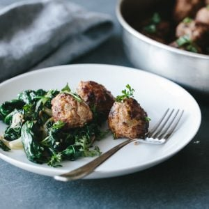 (gluten-free, paleo). Pork and Fennel Meatballs with Garlic Sautéed Spinach - The most delicious and flavorful pork meatballs, perfect for an appetizer or main meal.