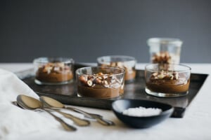 Chocolate avocado pudding with hazelnuts and sea salt. The most delicious fast and healthy dessert! Dairy-free, vegan and paleo.