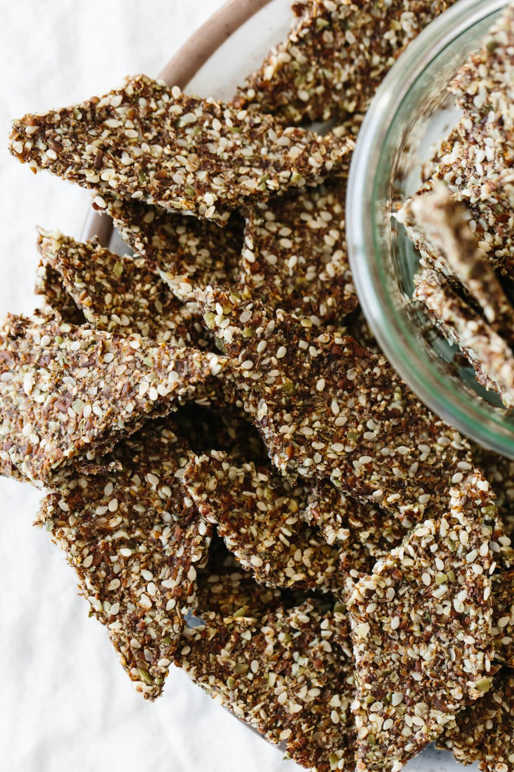 Flax seed crackers are a crunchy, flavorful, homemade cracker recipe that's naturally gluten-free, grain-free, nut-free, paleo and vegan. Made from flax seeds, chia seeds, sesame seeds and pumpkin seeds, they're super easy to make and great for snacking.