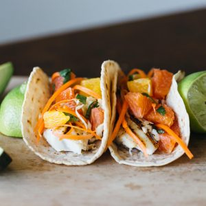 (gluten-free, paleo) Grilled fish tacos with citrus carrot slaw on cassava flour tortillas. A delicious new Taco Tuesday favorite!