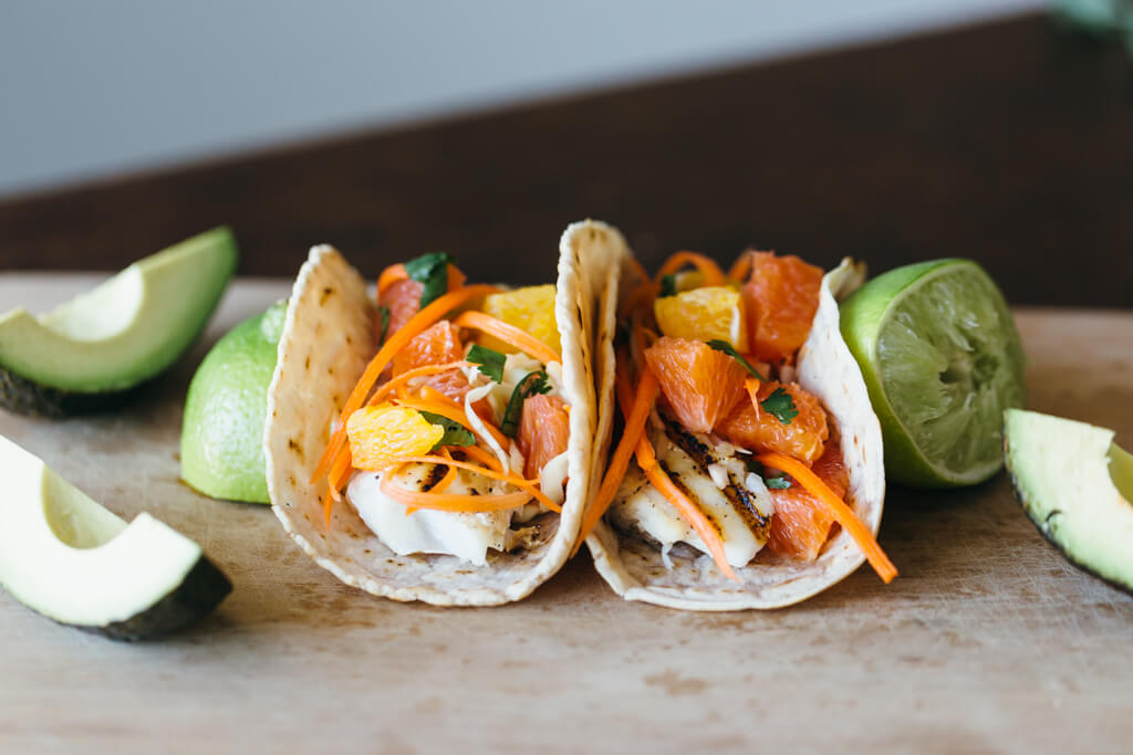 Grilled fish tacos with citrus carrot slaw on cassava flour tortillas. Gluten-free, grain-free and paleo.