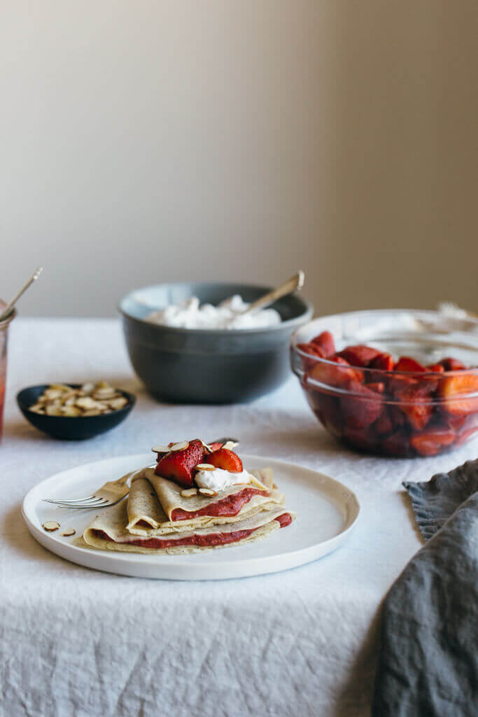 Vanilla bean cassava crepes with strawberry chia jam. A delicious breakfast that's gluten-free, grain-free, dairy-free and paleo (and perfect for Valentine's Day).