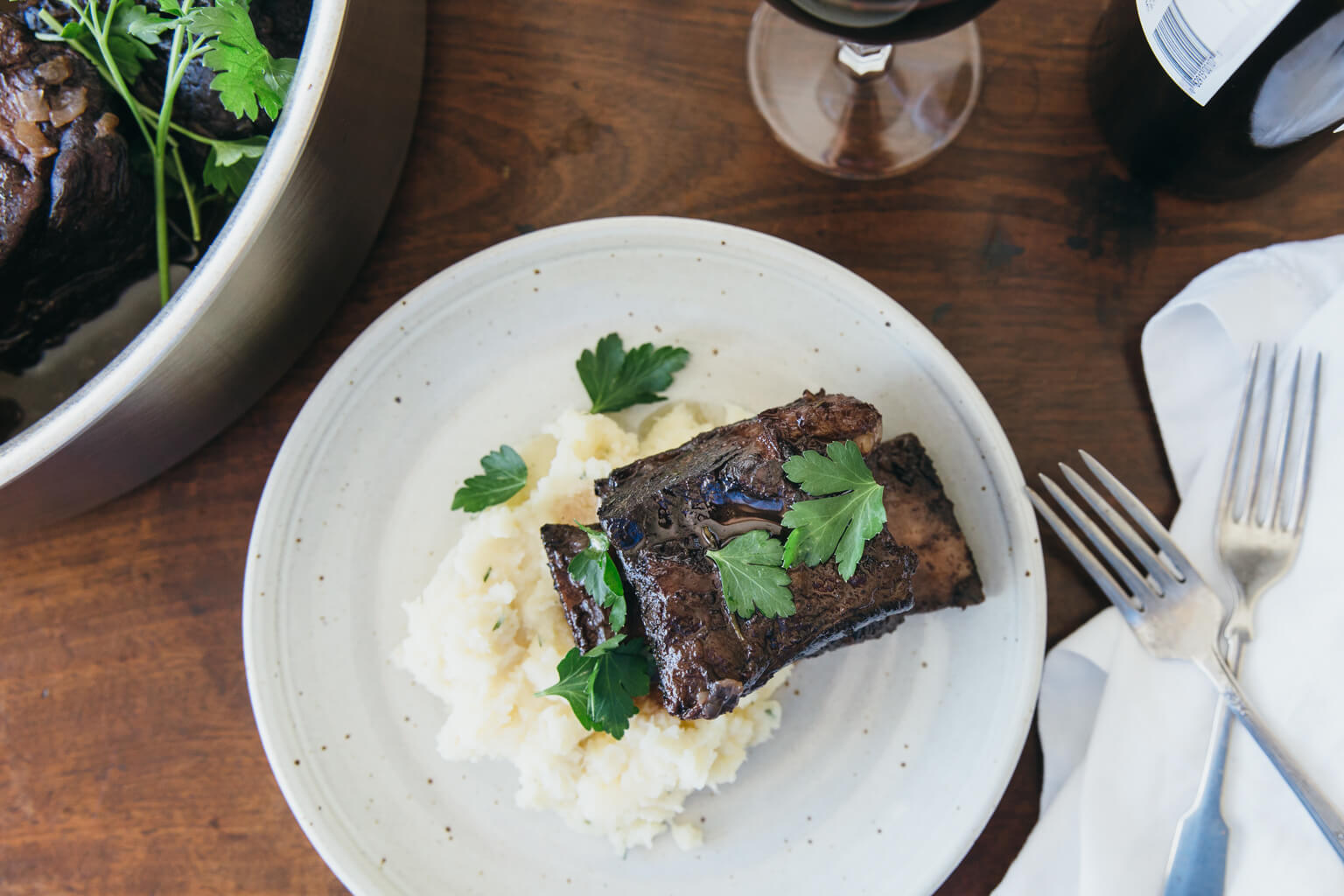 Cabernet-braised short ribs with rosemary root vegetable mash. Gluten-free and paleo.