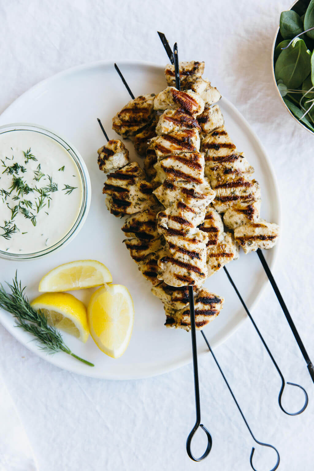 Grilled chicken souvlaki (lemon garlic chicken skewers) with dairy-free tzatziki. Gluten-free and paleo.