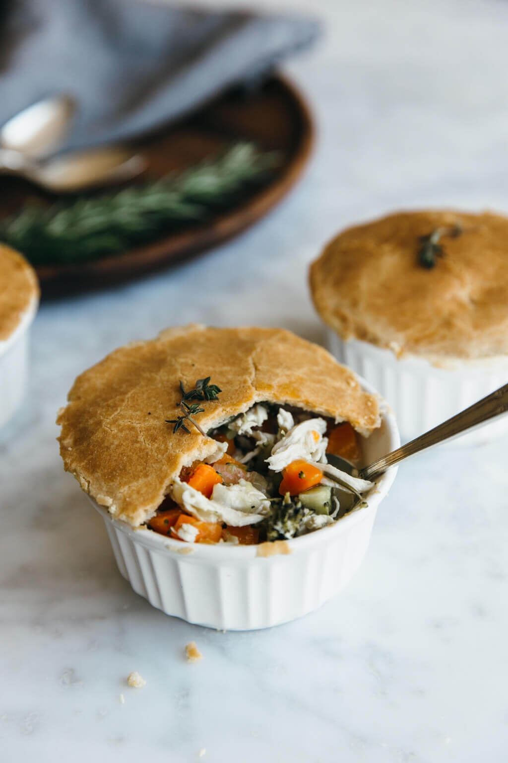 Paleo chicken pot pies that are mini in size and loaded with veggies, shredded chicken and a creamy, dairy-free filling.  They're gluten-free, grain-free, dairy-free and paleo - though you'd never know it.