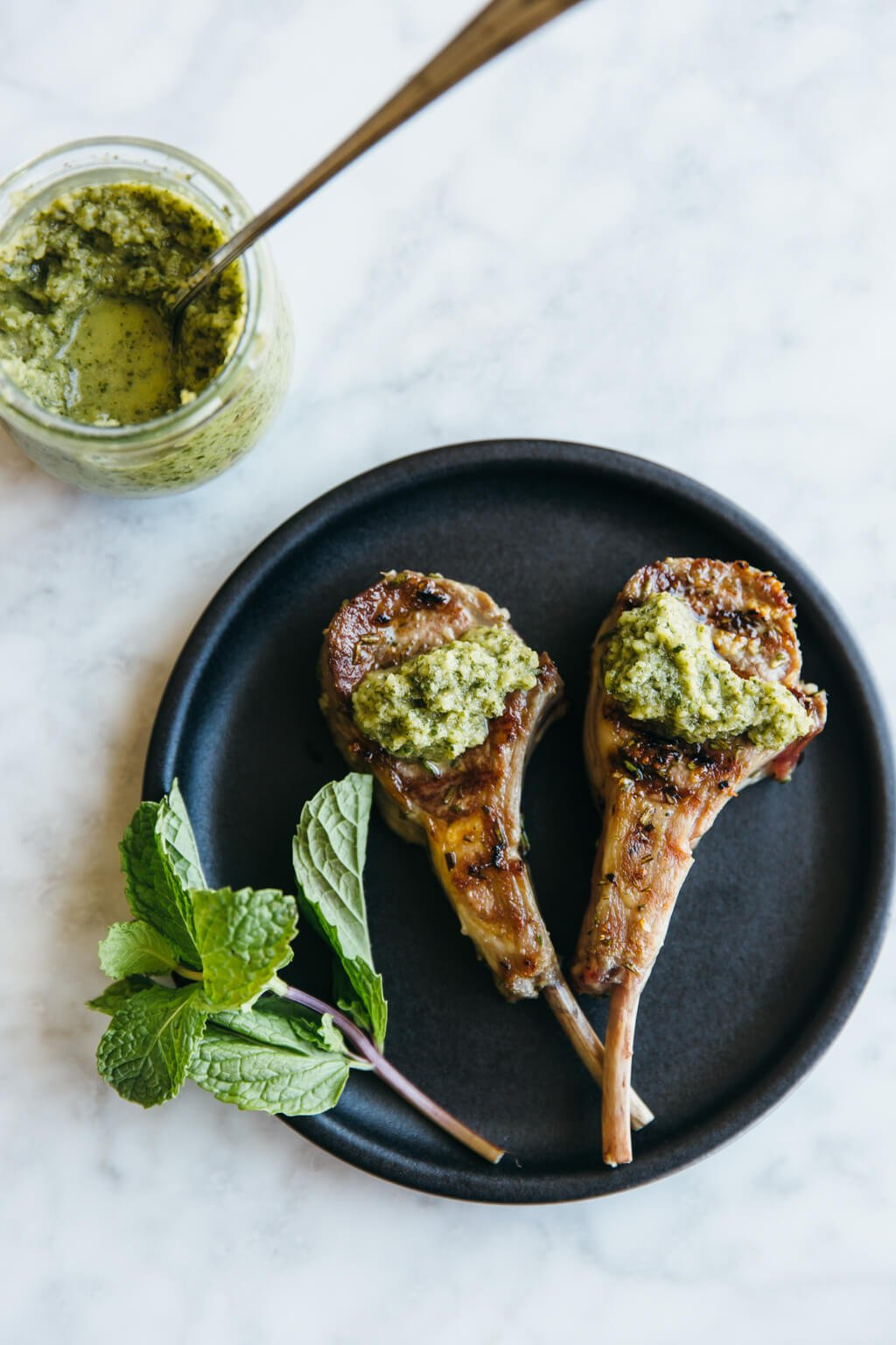 Rosemary grilled lamb chops with mint apple sauce. Paleo-friendly.