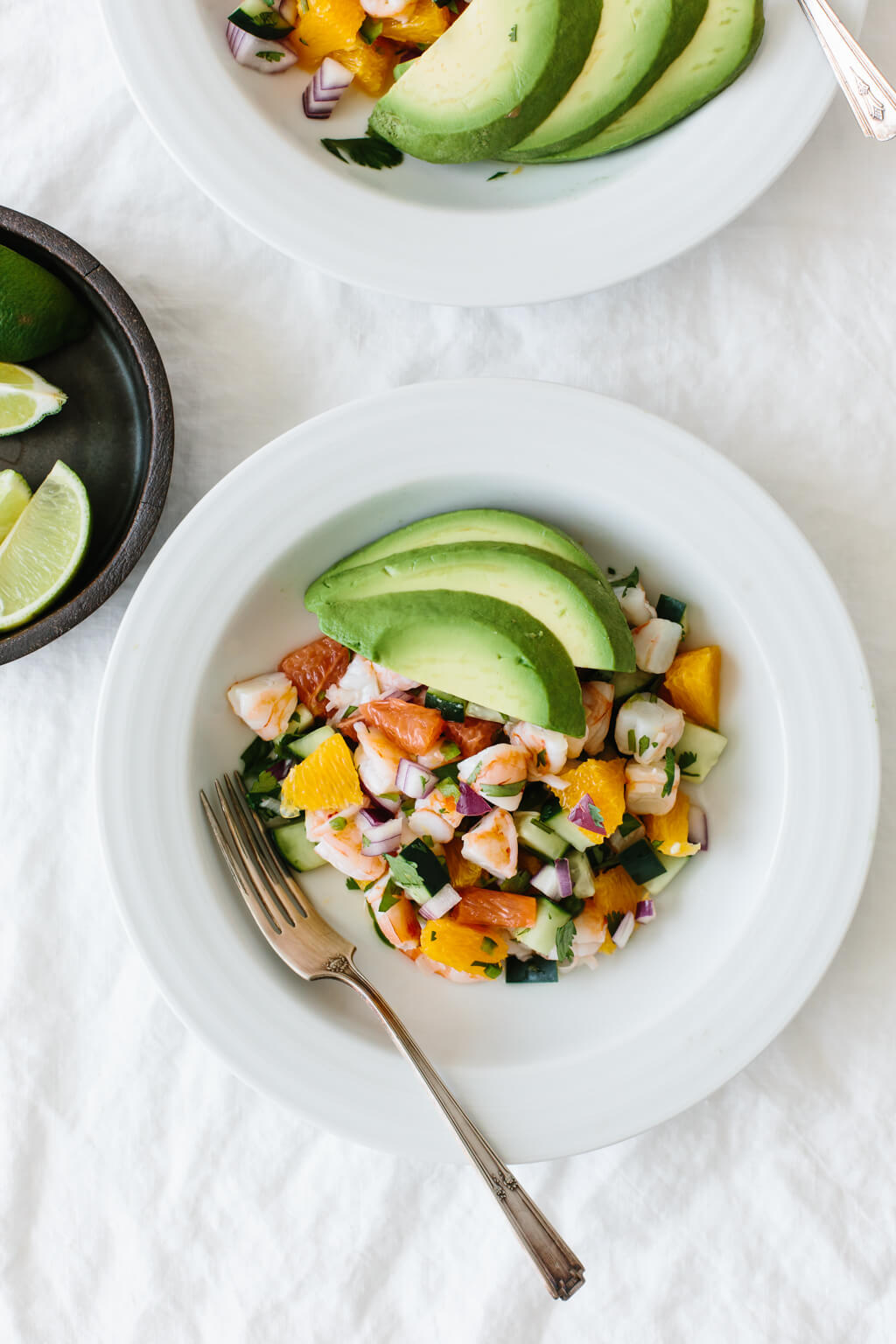 This shrimp ceviche is Mexican-inspired with a California citrus flair. It's amped up with orange and grapefruit, along with red onion, cucumber, jalapeno and cilantro for a bright, light and delicious shrimp ceviche recipe.
