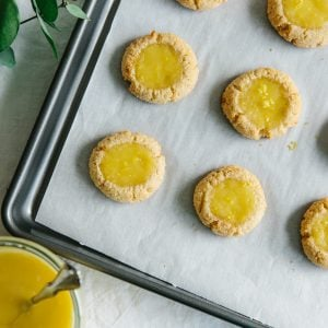 (gluten-free, paleo) Lemon curd thumbprint cookies. Almond flour cookies filled with the most delicious lemon curd.