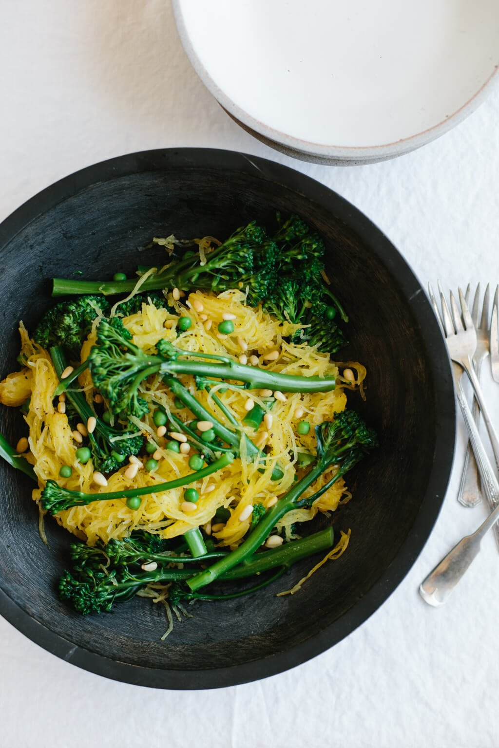 "Spaghetti squash with broccolini and truffle oil. This naturally gluten-free ""spaghetti"" is a healthy and delicious pasta alternative."
