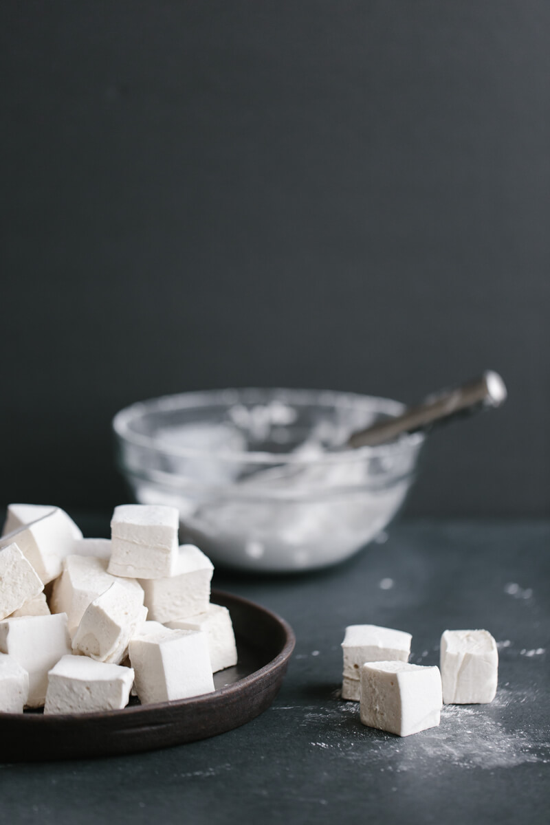 Healthier homemade marshmallows use honey or maple syrup instead of corn syrup and high-quality gelatin. They're also paleo friendly.