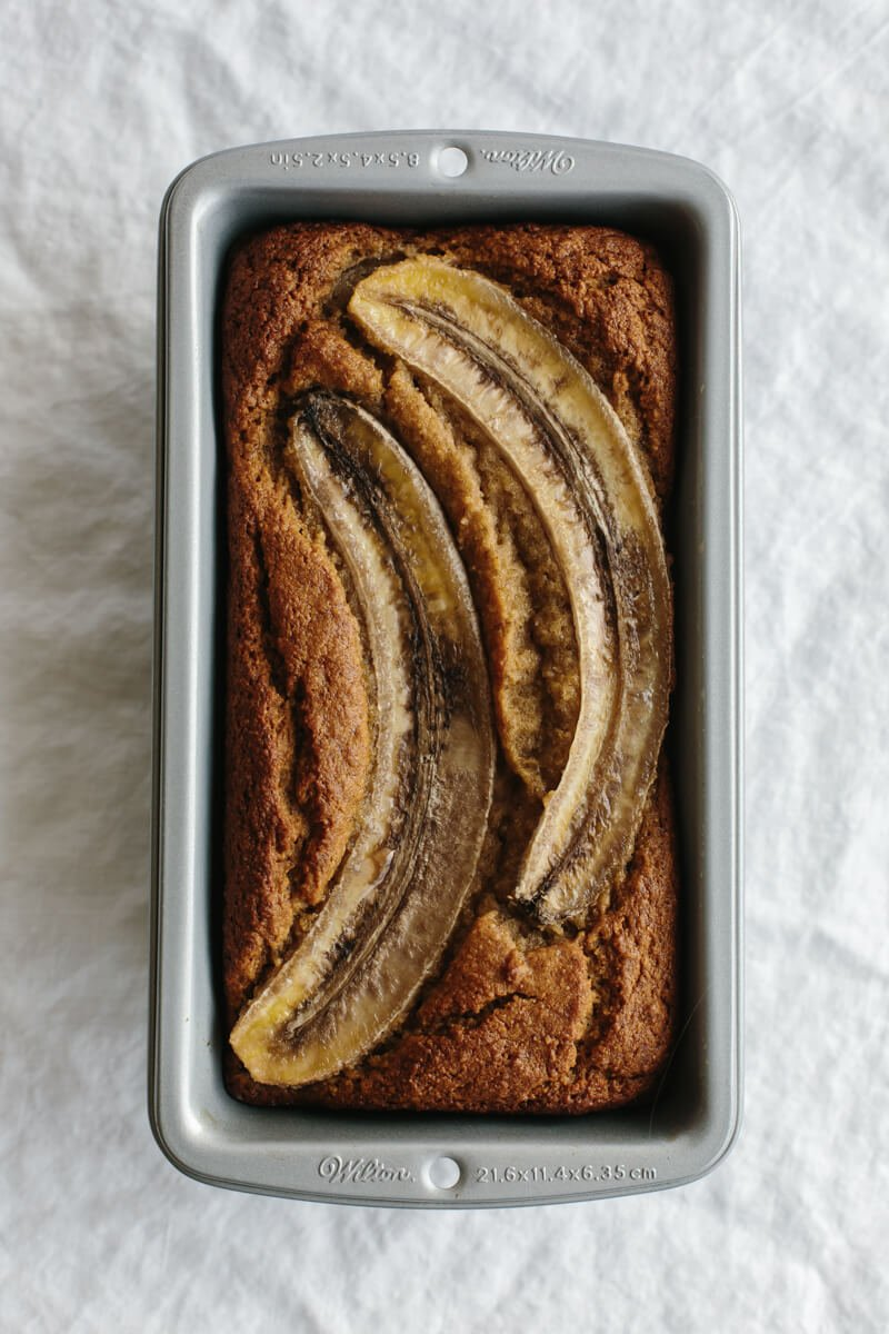 (gluten-free, paleo) This paleo banana bread recipe is healthy, super moist, delicious and easy to make as it only takes one bowl! It's also gluten-free, grain-free, dairy-free and paleo. Watch the video for step-by-step instructions.