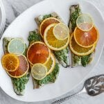 This roasted branzino with citrus pesto recipe is light, bright and extremely flavorful. It's sure to be your favorite fish recipe.