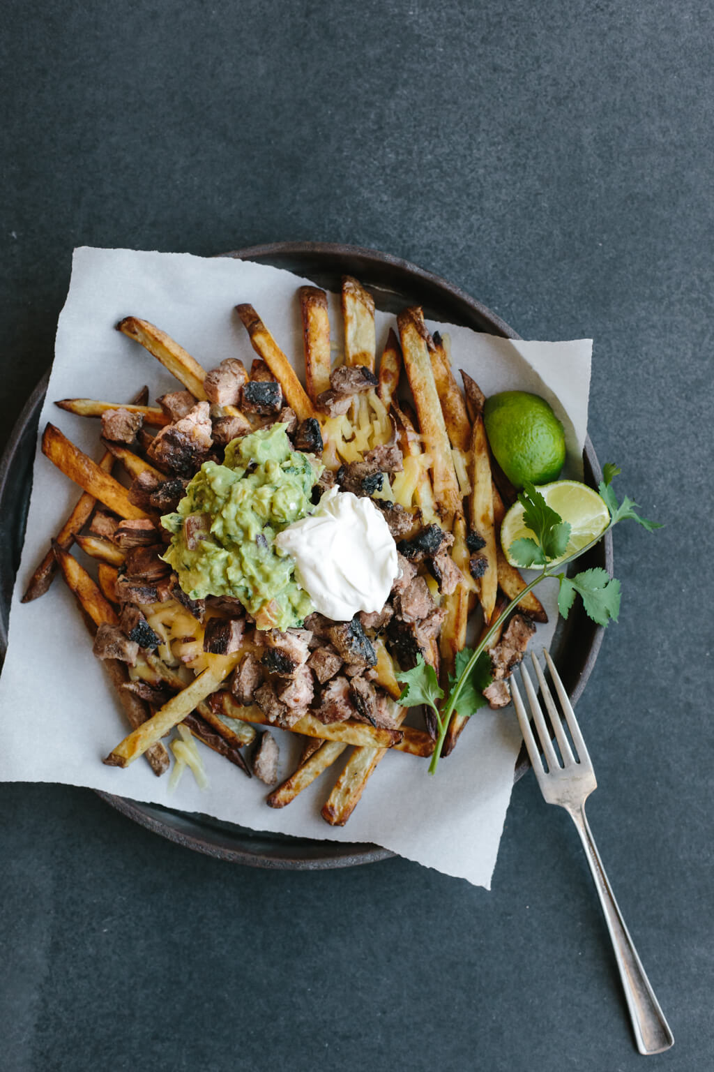 Carne asada fries are a San Diego classic and naturally gluten-free. A delicious snack or appetizer!