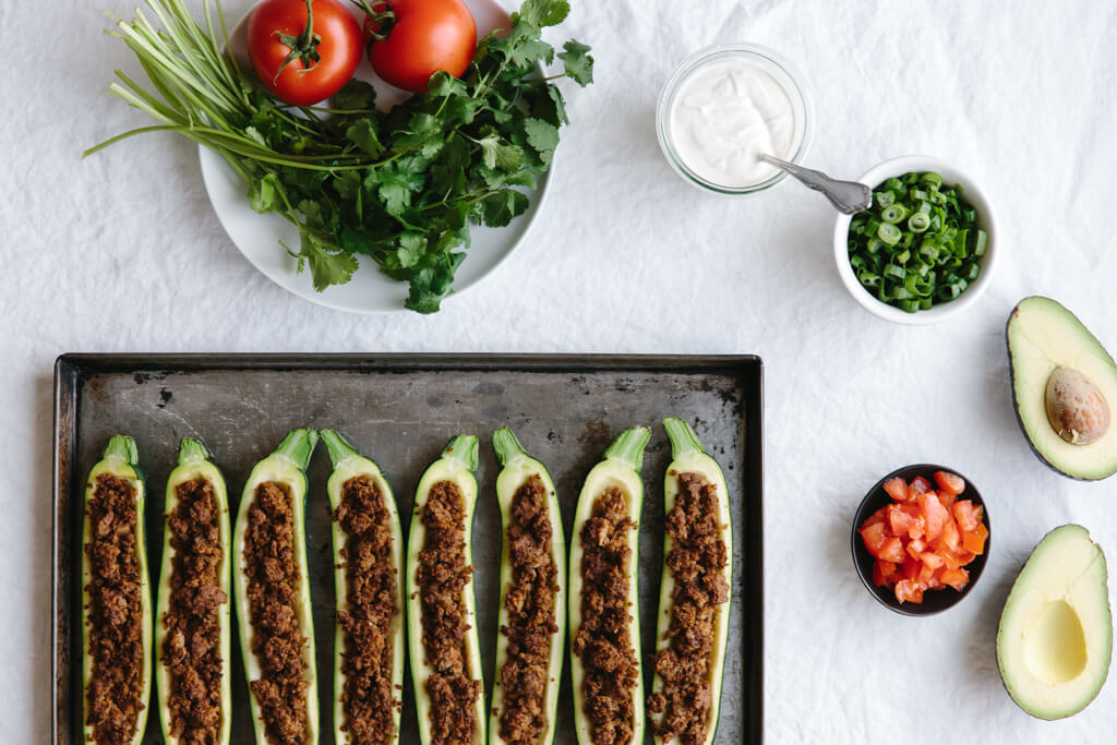 (dairy-free) These taco stuffed zucchini boats are the perfect healthy appetizer or main meal. They're also dairy free!