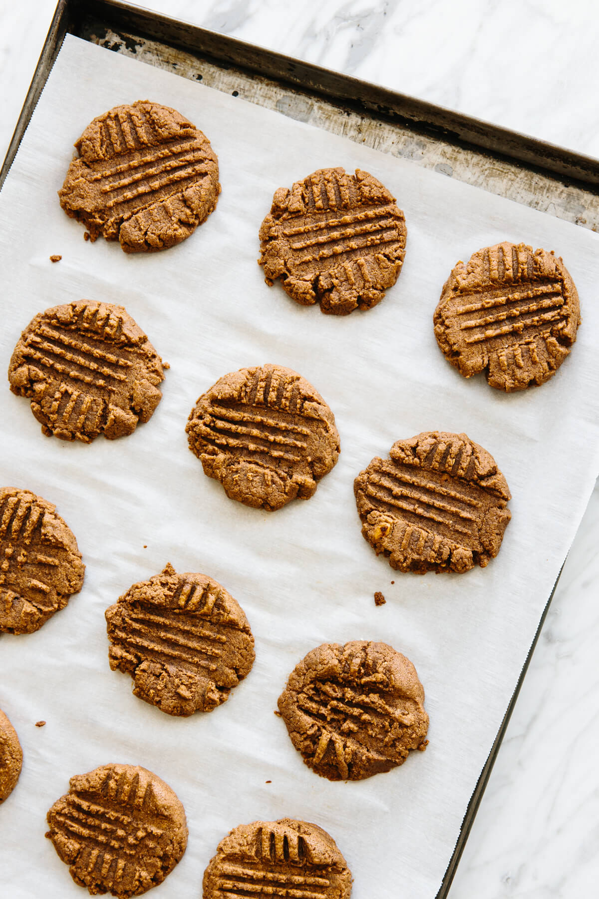 Almond butter cookies on a baking tray.