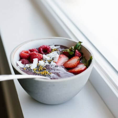 Acai bowl with mixed berries. A delicious, healthy, gluten-free smoothie bowl for breakfast or lunch.