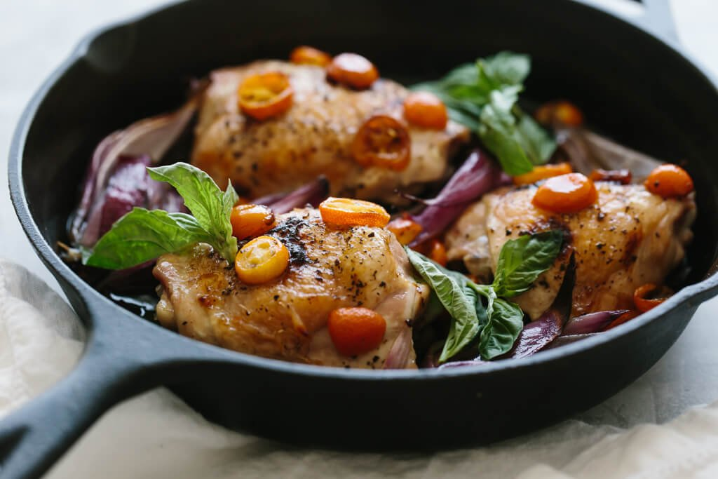 This one pan, roasted basil chicken is an easy meal that's bursting with flavor. Red onions and sliced kumquats become deliciously sweet when roasted.