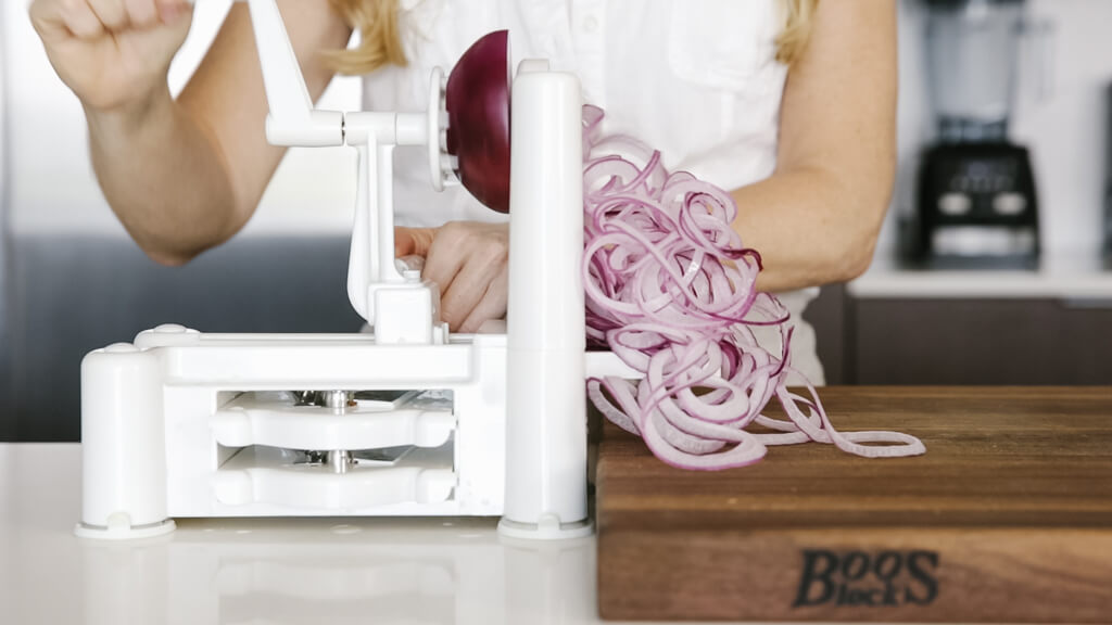 The spiralizer is one of my favorite kitchen tools. So today I'm sharing my favorite vegetables to spiralize along with veggie spiralizer tips and recipes. Learn how to spiralize red onion.