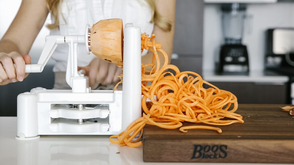 The spiralizer is one of my favorite kitchen tools. So today I'm sharing my favorite vegetables to spiralize along with veggie spiralizer tips and recipes. Learn how to spiralize sweet potato.