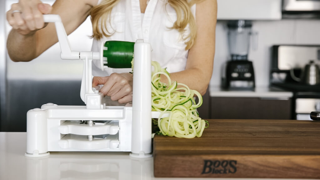 The spiralizer is one of my favorite kitchen tools. So today I'm sharing my favorite vegetables to spiralize along with veggie spiralizer tips and recipes. Here's how you spiralize zucchini.