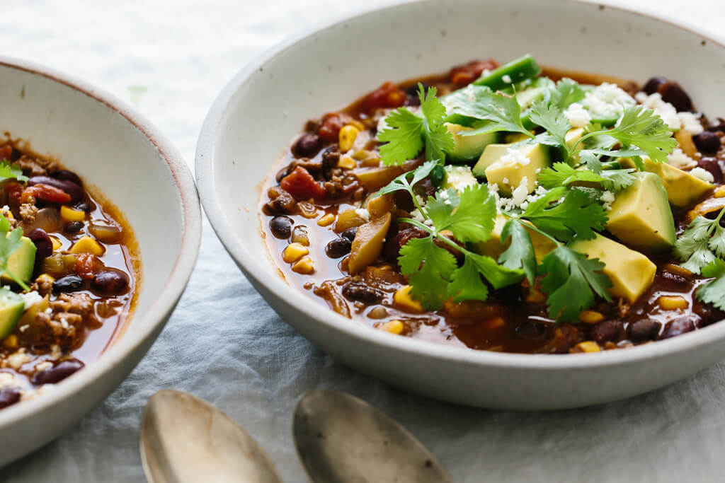 This taco soup recipe is guaranteed to be a family favorite. It's healthy, incredibly easy (only takes 30 minutes) and naturally gluten-free. The perfect healthy dinner!