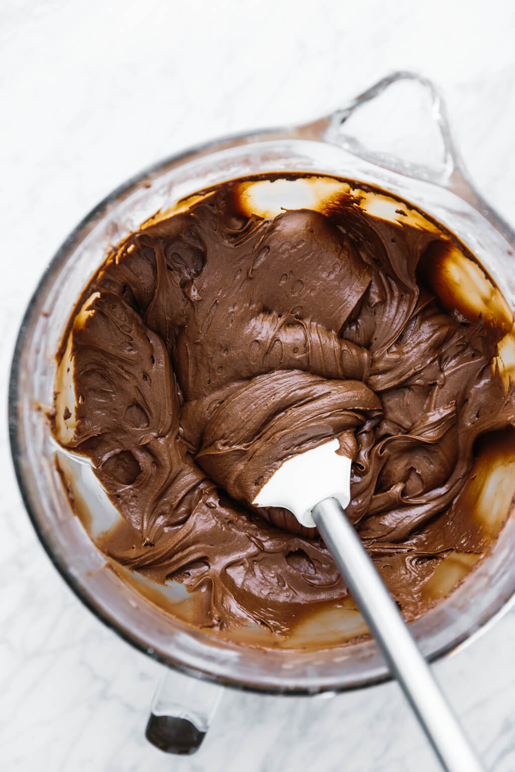 This vegan chocolate buttercream frosting is dairy-free and can be modified into a paleo buttercream frosting as well. It's rich, decadent and delicious!