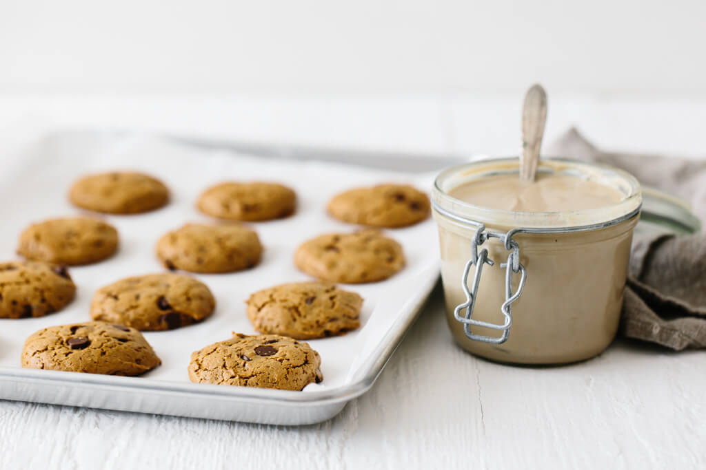 These flourless chocolate chip tahini cookies are gluten-free, nut-free and paleo. They're soft, chewy and utterly delicious. So easy to make! #TahiniCookies #Tahini #ChocolateChipCookies #CookieRecipe #Paleo #GlutenFree