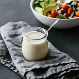 This lemon tahini dressing is oil-free, dairy-free and vegan. It's a tasty, creamy, zesty salad dressing that's super versatile and adaptable. #LemonTahiniDressing #Tahini
