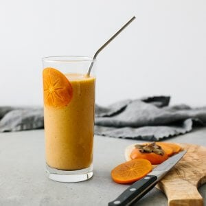 This persimmon smoothie is the perfect smoothie for fall. Made with persimmons, banana, ginger, cinnamon and cloves, it's slightly spiced and deliciously sweet.