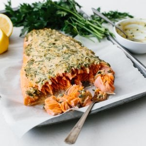Baked salmon being eaten with a fork.