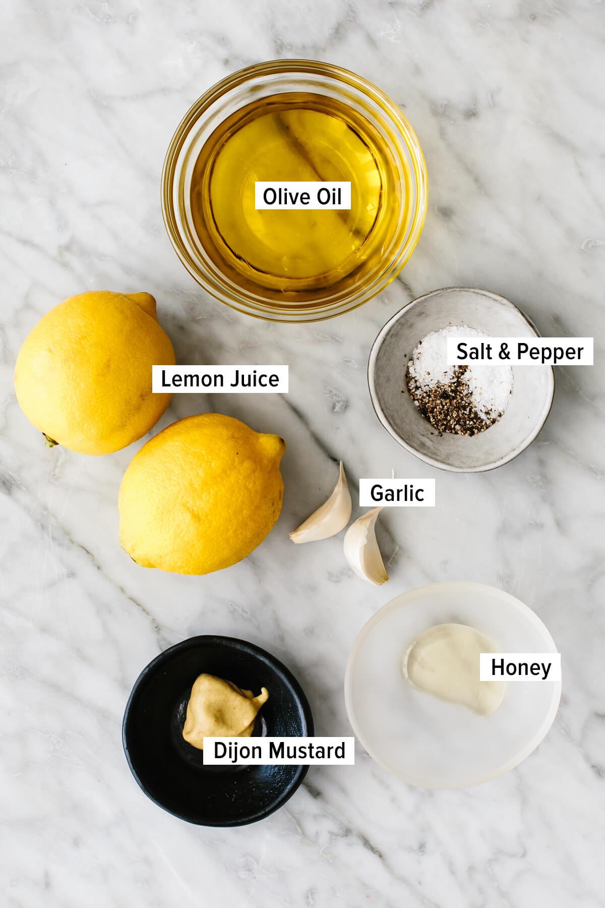 Lemon vinaigrette dressing ingredients on a table.