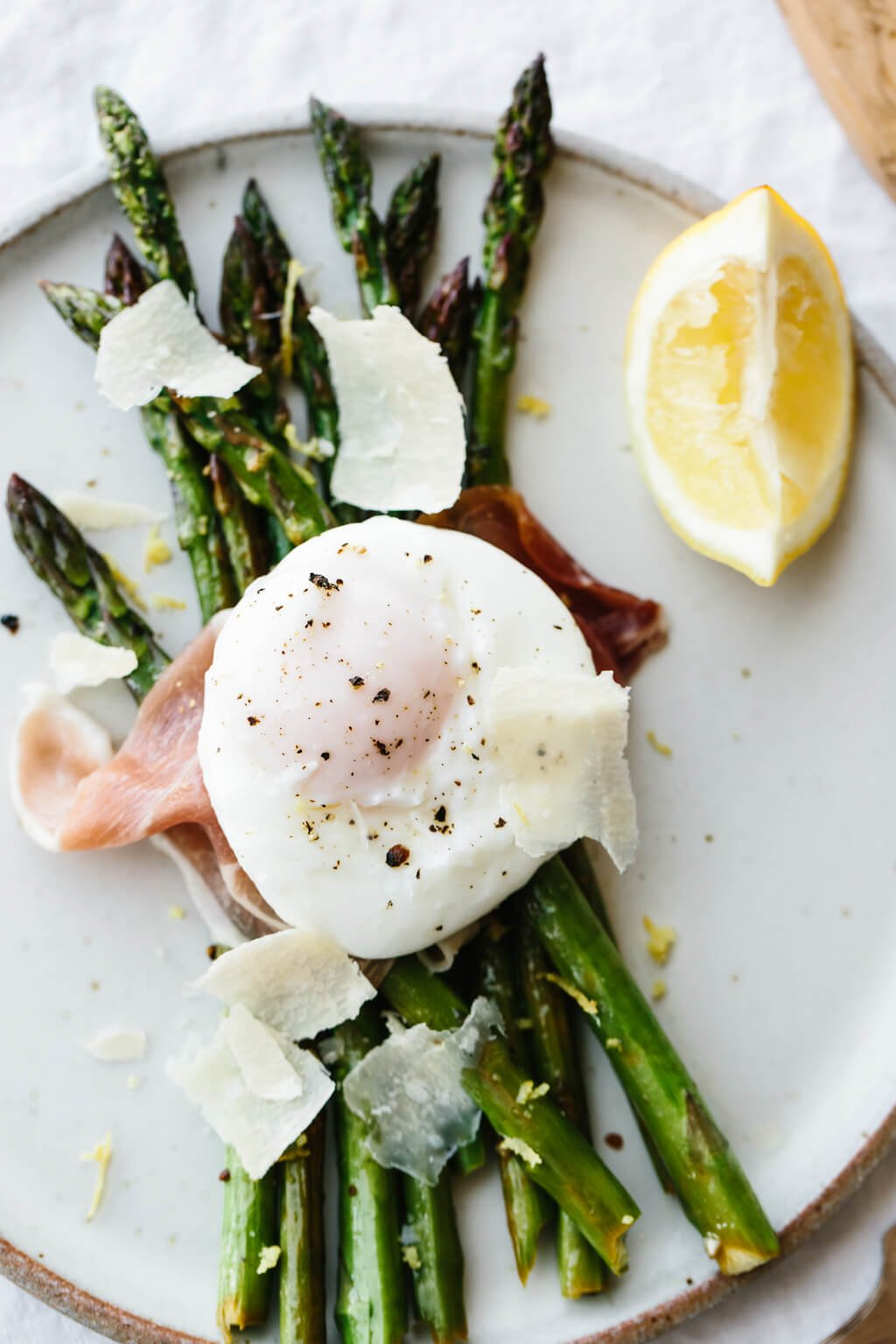 Breakfast doesn't get much better than garlic sautéed asparagus topped with prosciutto, a perfectly poached egg and a few shavings of parmesan.