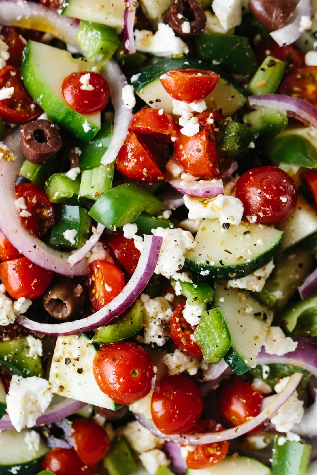 This Greek salad is easy to make and bursting with flavor. With only six ingredients - cucumbers, tomatoes, bell pepper, red onion, olives, feta - it's one of the best healthy salad recipes.