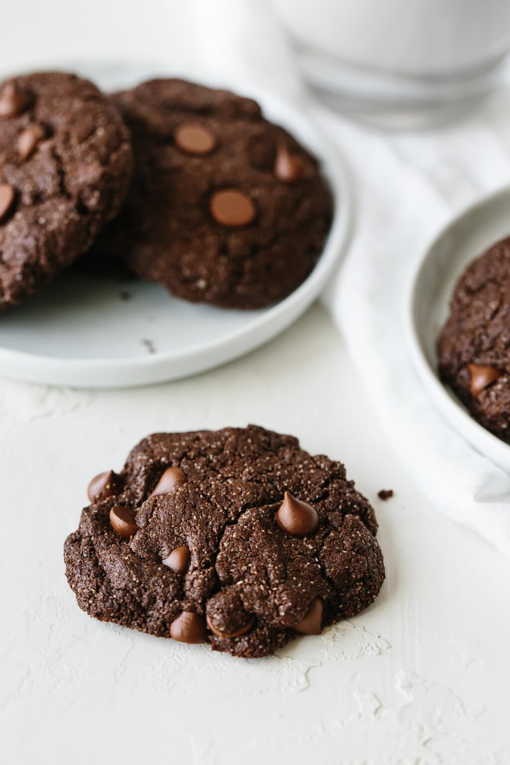 These gluten-free, paleo-friendly mint double chocolate cookies are rich, decadent and highly addictive. They're firm on the outside and lusciously soft on the inside.