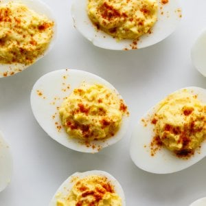 Deviled eggs are hard boiled eggs where the yolk is mixed with mayonnaise, mustard, vinegar, salt and pepper. A little sprinkle of paprika on top helps make these the best deviled eggs recipe.