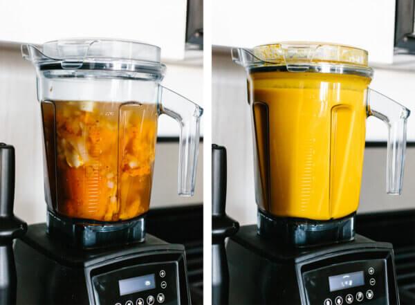 Blending the butternut squash soup ingredients in a blender.
