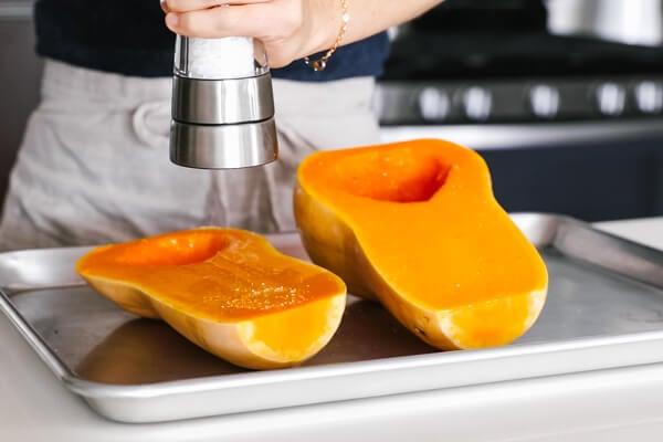 Seasoning the butternut squash.