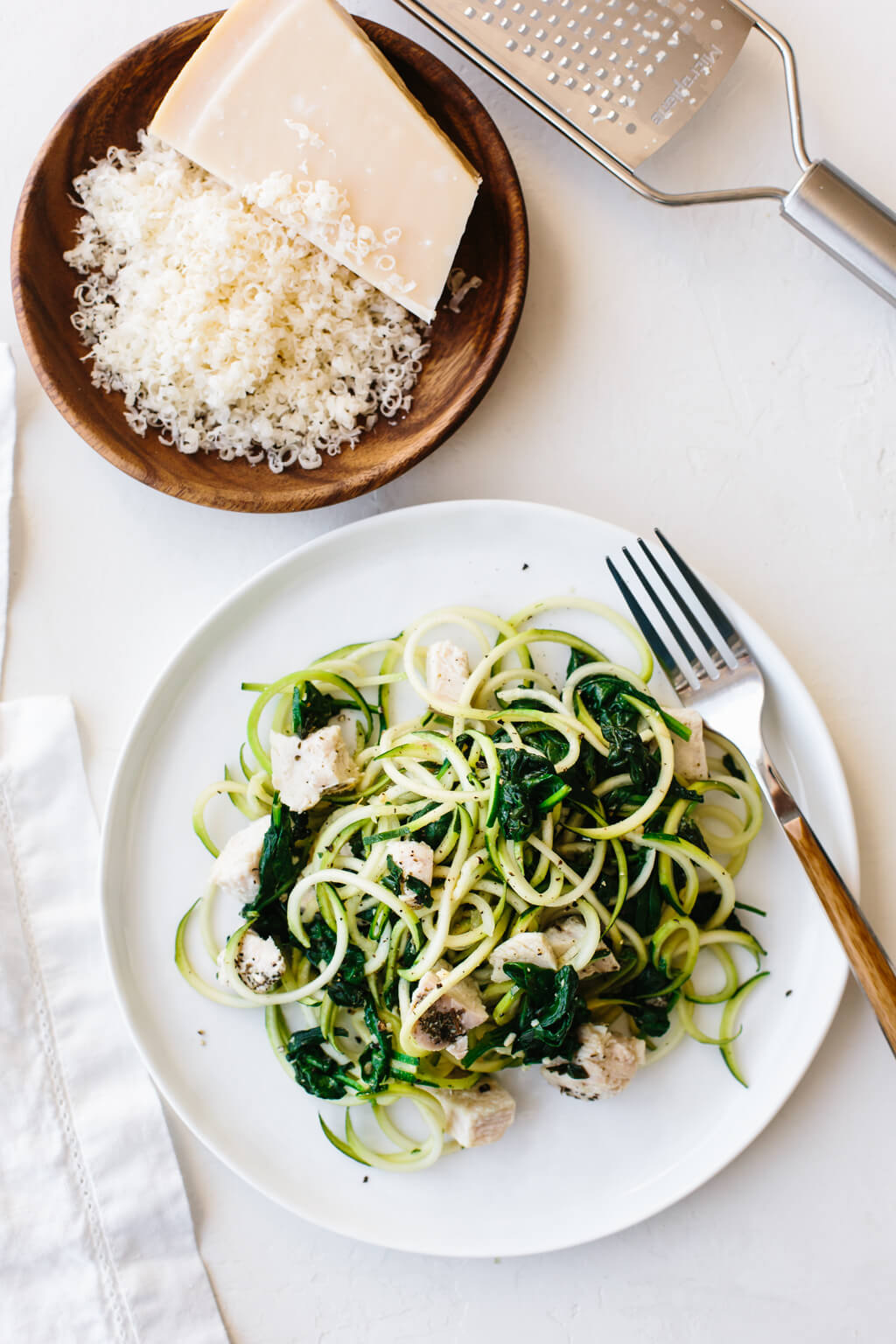 Zucchini noodles with chicken, spinach and parmesan are an easy, gluten-free, paleo, low-carb and keto friendly zucchini noodles recipe.