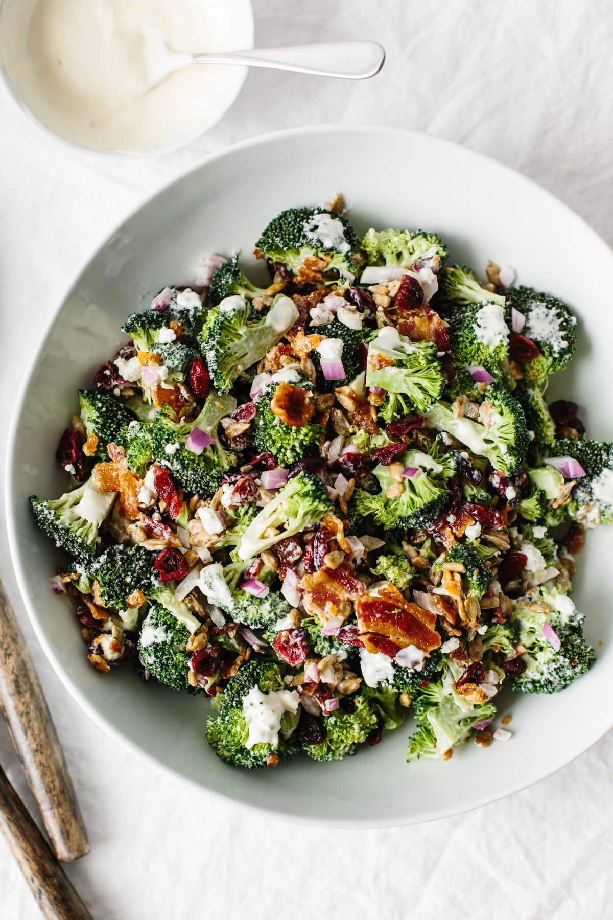 Broccoli salad in a white bowl.