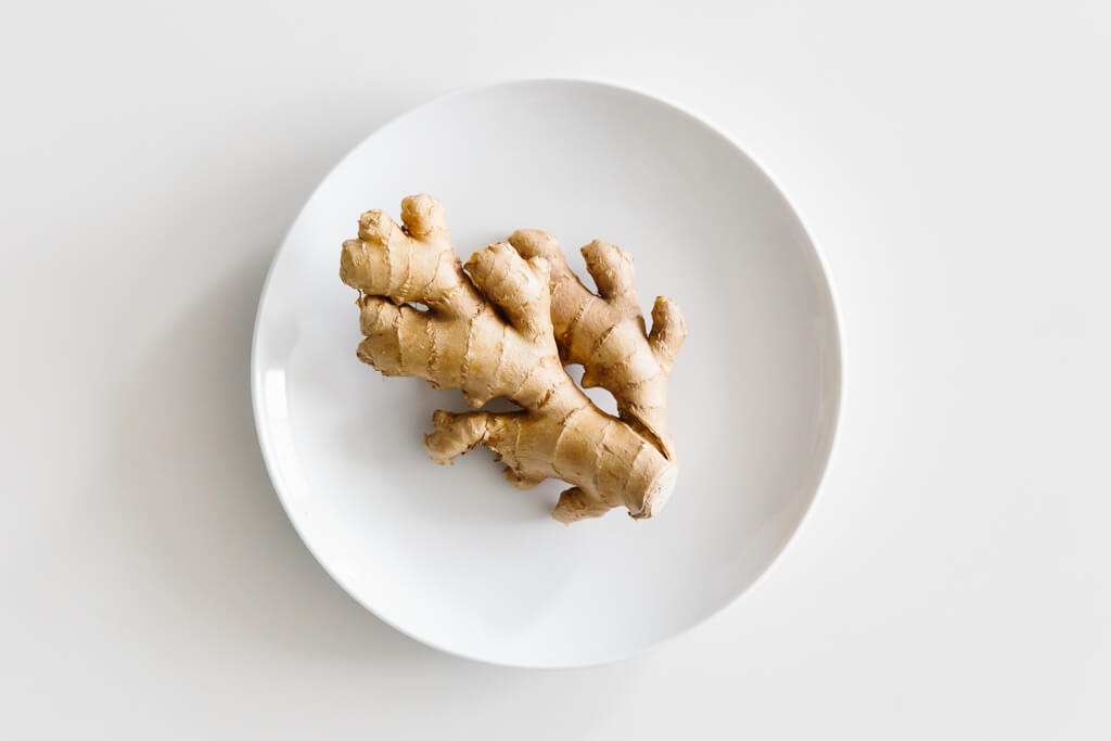 Plate of ginger on a white table.