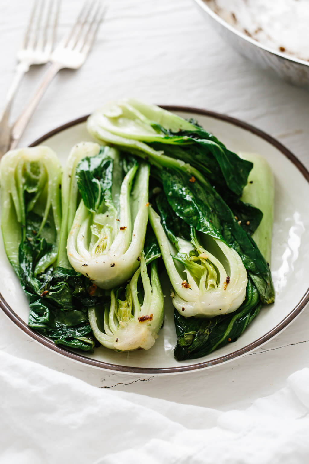 Bok choy cooked with garlic and ginger in a quick stir-fry recipe. It's nutritious, tasty and packed with health benefits.
