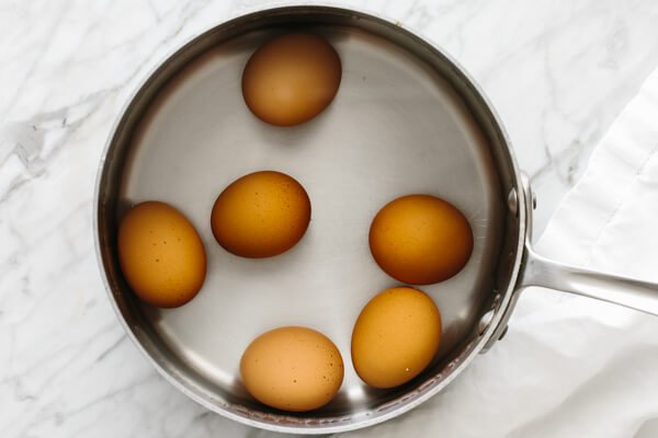 Boiling eggs in a pot.