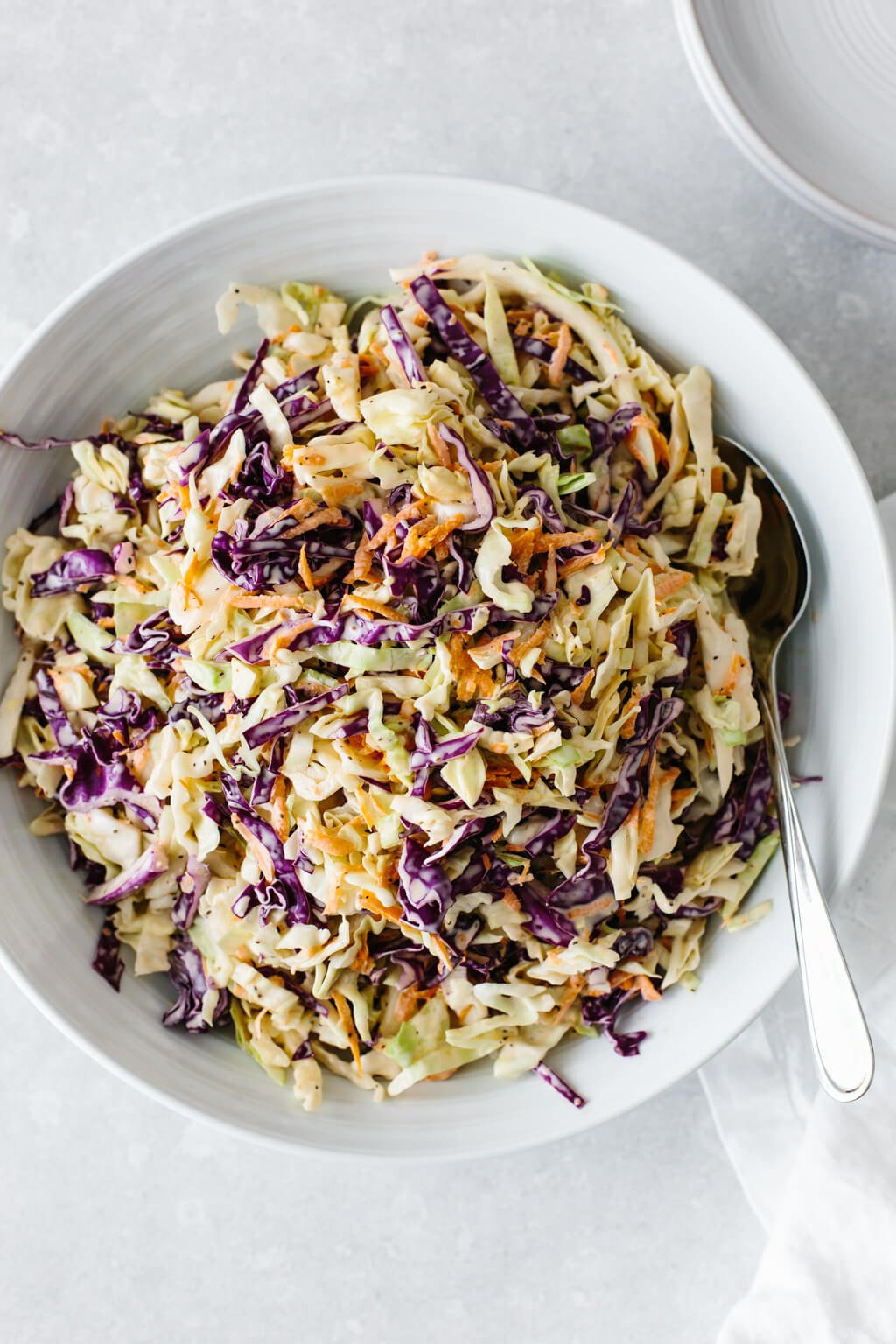 Coleslaw in a white bowl.