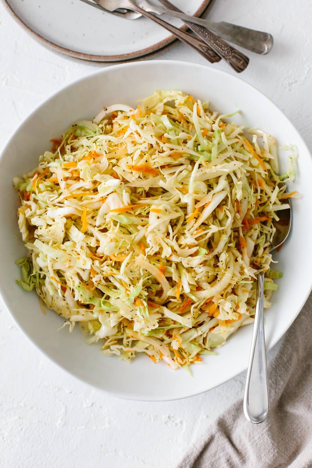 Vinegar based coleslaw in a white bowl.