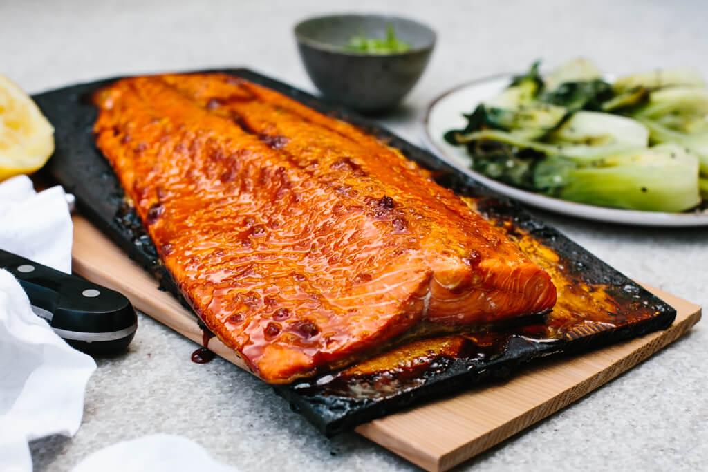 Cedar plank salmon on charred grilling planks.