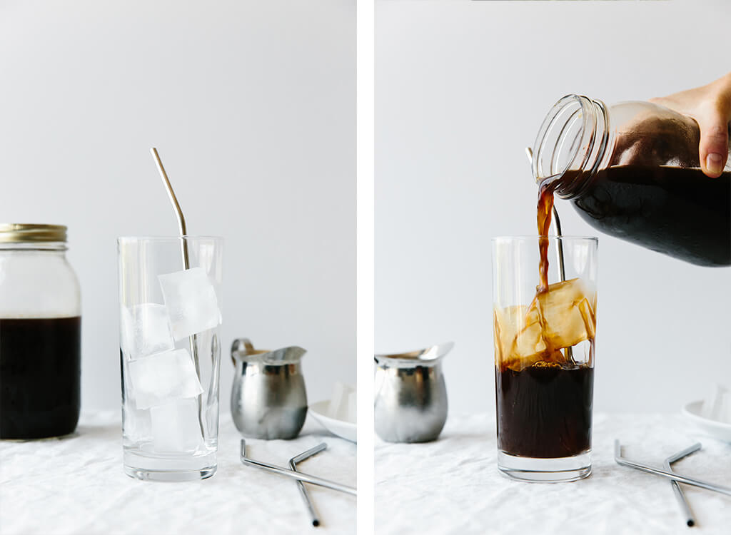 Pouring cold brew concentrate into a glass with ice.